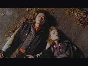 Chang Lee (Yee Jee Tso), Grace (Daphne Ashbrook) dead on ground