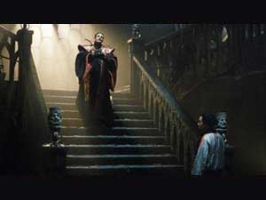 The Master (Eric Roberts) descends the stairs to a waiting Chang Lee (Yee Jee Tso)