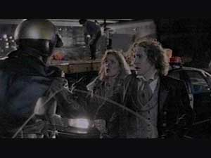 Motorcycle policeman (Bill Croft), stops Grace (Daphne Ashbrook), and the Doctor
