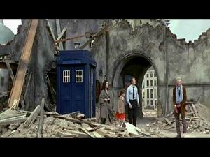Doctor, Tom and Susan outside the TARDIS