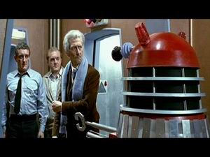 Tom, Brockley (Philip Madoc),  and the Doctor stopped by a Dalek